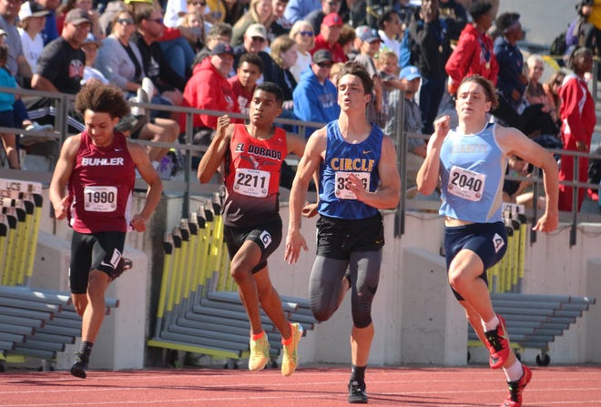 El Dorado's Tylen Ashihi (second from left) and Circle (third from left) race in the boys' 4A 200-meter dash in Friday's Class 4A state track and field meet at Cessna Stadium in Wichita, Kansas