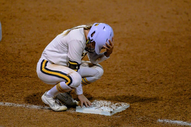 Mizzou's Brooke Wilmes (7) holds her head down at first base after popping out for the final out of the Tigers' super regional game against James Madison Friday night at Mizzou Softball Stadium.