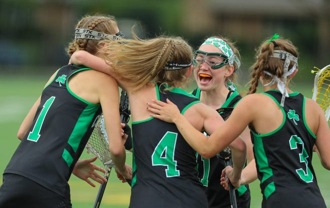 Dublin Coffman's Bailey Morris (4) is congratulated by teammates after scoring against Upper Arlington on Friday.