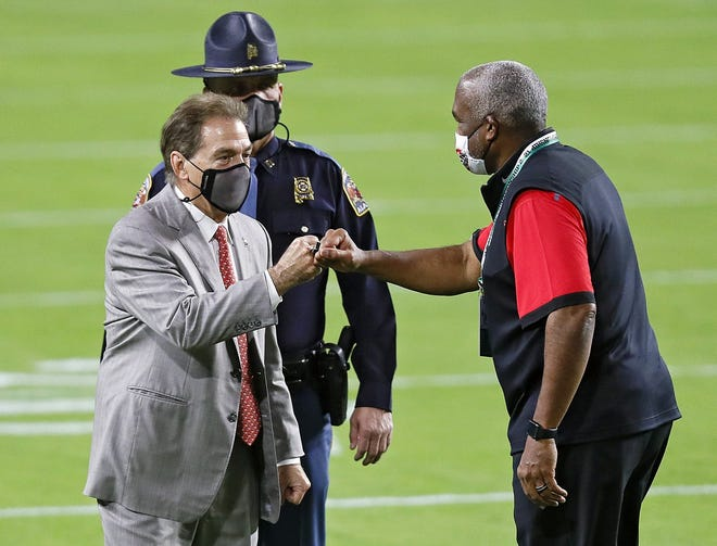 Ohio State athletic director Gene Smith, right, greets Alabama football coach Nick Saban before the national championship game on Jan. 11. Could pending name, image and likeness rules give Alabama an advantage over Ohio State in its pitch to recruits?