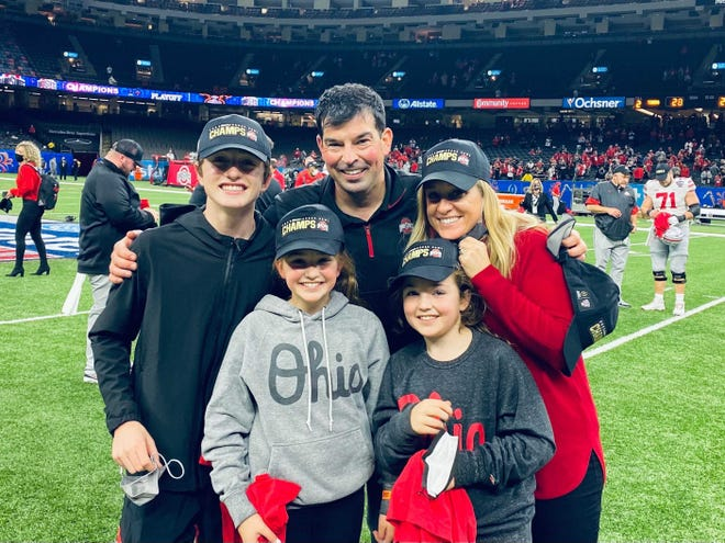 The Day family – from left, RJ, Grace, Ryan, Nia and Nina – celebrate on the field after Ohio State's victory over Clemson on Jan. 1 at the Sugar Bowl.