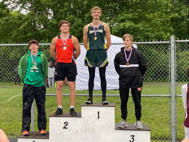 Shenandoah senior Max McVicker stands atop the championship podium on Friday evening at Massillon Perry High School after winning the 300-meter hurdles championship at the Division III Regional track meet.  McVicker advances to the OHSAA State Track Meet next weekend.