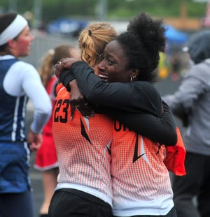 Dalton's Amelia Knetzer hugs Lauren Clos after they win the Regional Girl 4x200 Relay to get them to state.