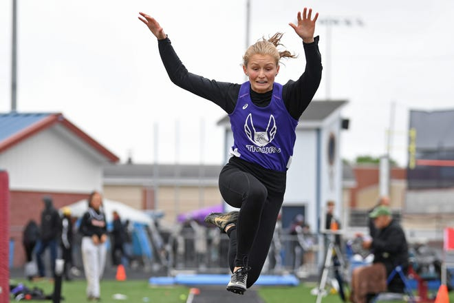 Triway's Kalie Campbell competes during the girls long jump, Saturday during the the Division 2 Regional Track Meet at Austintown Fitch High School. Campbell qualified for state with a jump of 16-7.
