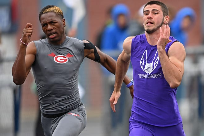 Triway's Cameron Soss (right) competes during the boys 100m dash, Saturday during the the Division 2 Regional Track Meet at Austintown Fitch High School. (David Dermer/Special to the Record Courier)