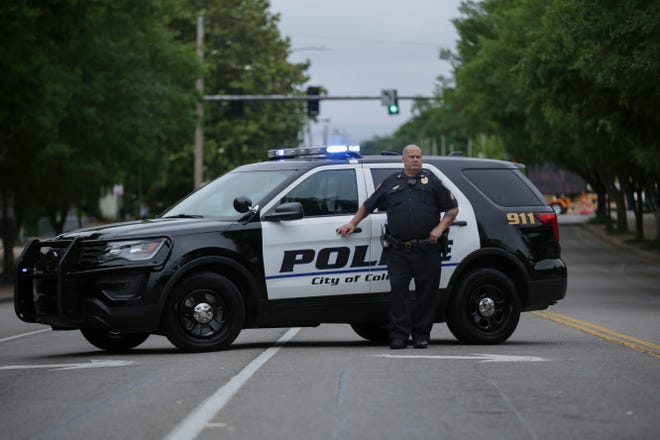 Columbia Police Department Patrol Officer Sgt. Keith Fall blocks off West 7th Street before the start of the Maury County MuleFest parade in Columbia, Tenn., on Saturday, May 29, 2021.