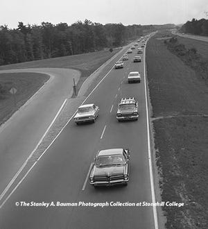 In this May 31, 1965, photo, a never-ending flow of traffic is seen on Route 3 looking south from the Route 53 bridge in Hanover, near the Norwell line, as vehicles stretched as far as the eye could see around 7 p.m. on that Memorial Day.