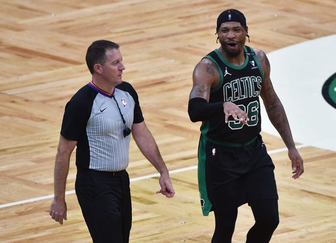Celtics guard Marcus Smart talks with an official after a controversial call. Smart has reportedly signed a four-year contract extension to stay in Boston.