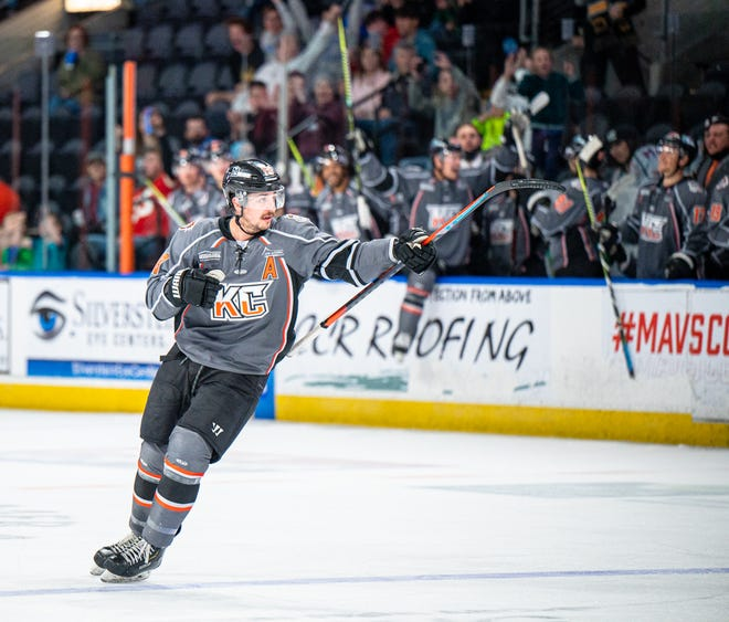 Kansas City Mavericks forward Darik Angeli points to teammate Lane Scheidl after assisting on Scheidl's goal in a game at Cable Dahmer Arena last season. Angeli has agreed to return to the Mavericks this season, joining Scheidl.