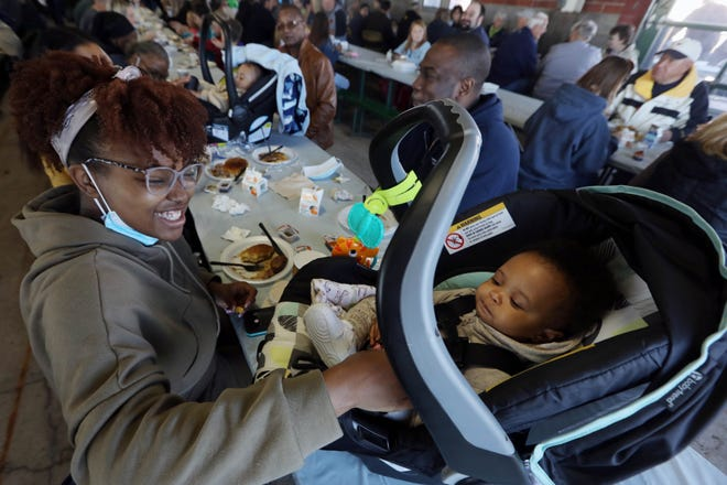 Serra Matin gives her 8-month-old son, Kileal, some food Saturday during the Burlington Kiwanis Club's annual pancake breakfast at the Port of Burlington. The breakfast serves as the Kiwanis Club's largest fundraiser with the money raised supporting local projects that benefit the youth of Des Moines County.