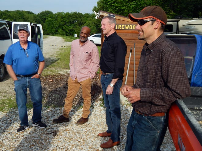 Des Moines County supervisors Jim Cary, Shane McCampbell and Tom Broeker share a moment with DMC Conservation Director Chris Lee, right, Thursday during a tour of the county's three main public camping areas.
