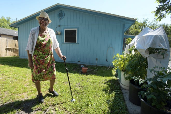 Doretha Tompkins, a founding member of the Riverview Neighborhood Association, stands behind her Fourth Avenue home where the septic tank and drain field take up most of the small backyard. She said $100 million for septic tank phaseouts will make a big improvement in the neighborhood's long-term outlook.
