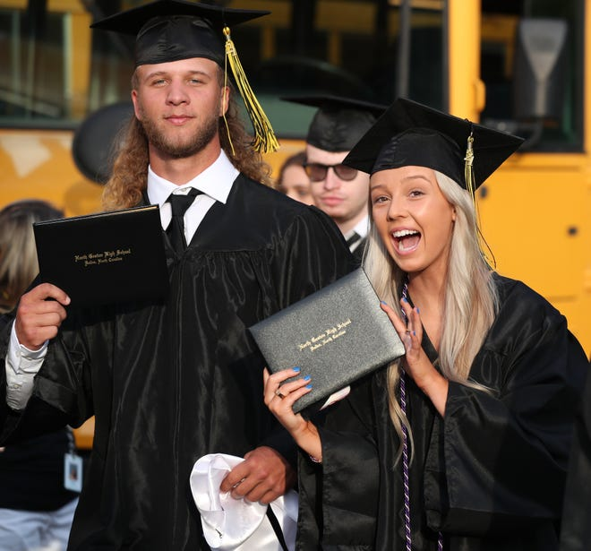 Class of 2021 North Gaston graduates Will Farnsworth and Payton Ballard pose for a picture after graduation on Friday, May 28, 2021.