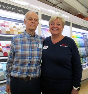 Arnie Swanson, now retired, who worked at Geneseo Farm & Fleet for 42 years and was store manager for 35 of those years, poses for a photo with Farm & Fleet company president and CEO Jane Blain Gilbertson, Janesville, Wis.