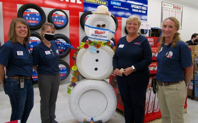 Jane Blain Gilbertson, third from left, president and CEO of Blain's Farm & Fleet Stores, visited with staff at the Geneseo Farm & Fleet store to help them celebrate the 55th plus 1 anniversary of the opening of the Geneseo store. With Gilbertson are, from left, Tracy DeMay, assistant manager; Michelle Neilbaumgardner, store manager; and Liz Parrish, assistant manager.