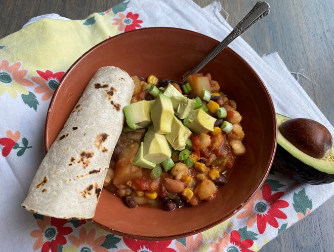 This recipe comes together quickly with the help of a few canned or frozen staples. Along with beans, hominy and corn, you can add canned or fresh tomatoes, freshly diced onion, and minced garlic.