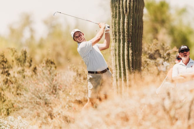 Texas Tech golfer Garrett Martin hits an iron during the second round of NCAA championship tournament Saturday in Scottsdale, Arizona. The Red Raiders, leading the 30-team field after Friday's first round, went skidding down the leaderboard Saturday.