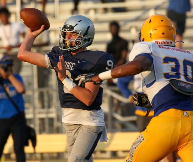 Ridge Community quarterback Zach Pleuss fires a pass against Auburndale on Friday night during the spring game at Ridge.