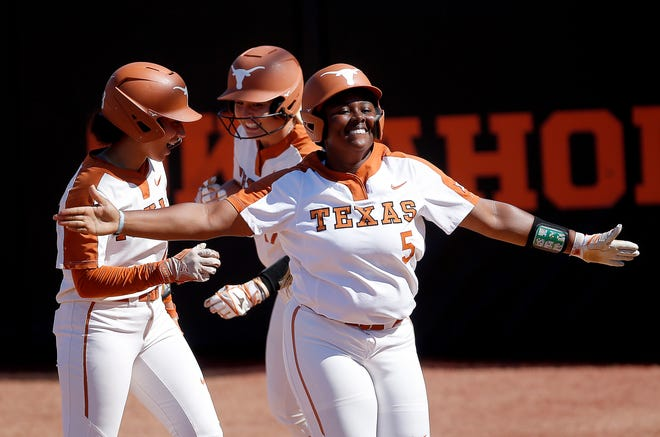 Texas freshman Jordyn Whitaker celebrates her game-tying solo home run in the sixth inning that served as a prelude to Mary Iakopo's two-run homer for a 4-2 win Saturday that put the Longhorns within one win of the Women's College World Series.