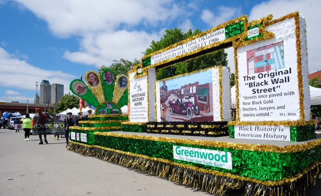 A float celebrating Historic Greenwood participates recently in the Centennial Black Wall Street Heritage Parade on Greenwood Avenue.