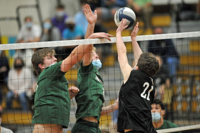 Hendricken's Ryan Osely, left, can't squeeze this hit past North Kingstown's Ethan Smith during Friday's battle of unbeaten teams.