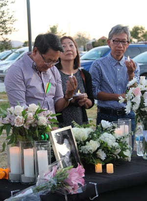 Tom Pham, father of Katie Pham, stands with family members as he speaks at a vigil remembering Katie May 27, 2021 at Petroglyph Park in Ridgecrest