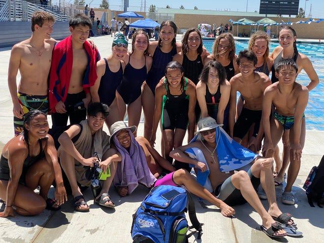 The 2021 Burroughs swim team. From left, standing, top row: Adrian Riendeau (jr), Douglas Bui (so), Rebecca Moulton (jr), Taylor Frisbee (jr), Grace Lormand (jr), Hannah Freese (sr), Olivia Harvey (jr), Megan Small (jr) and Jenna Cope (jr). Middle row, sort of standing, from left: Alyssa Pepper (sr), Rachel Thomas (sr), ZJ Hoffman (jr) and Andrew Bui (fr). Bottom row, seated/lying down, from left: Princess Monica Monsalud (fr), Sean Pecore (so), Thomas Bui (sr), Owen Wong (so).