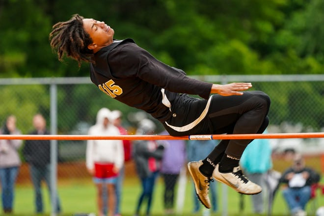Junior Bert Jones from Windham jumps at the regional finals at Massillon Perry High School on May 28, 2021.