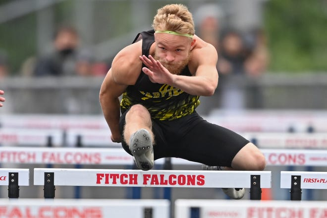 Garfield's Ryan Stoller competes during the boys 110m hurdles, Saturday during the Division 2 Regional Track Meet at Austintown Fitch High School.