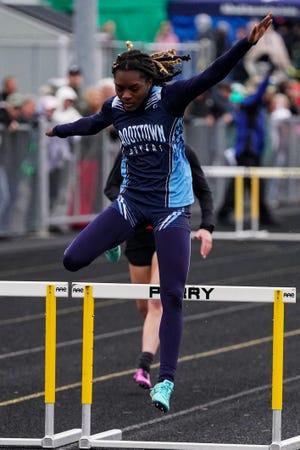 Marinna Atanmo runs the 300 hurdles at the regional finals hosted by Massillon Perry High School on May 28, 2021.