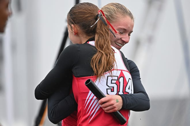 Field's Rachel Ruggles gets a hug from a teammate after winning the girls 4x400m relay, Saturday during the Division 2 Regional Track Meet at Austintown Fitch High School.