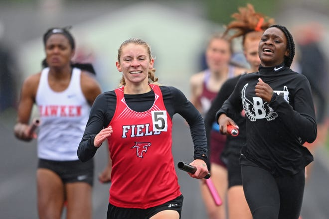Field's Rachel Ruggles races to the finish line against Buchtel's Damya Barker during the girls 4x400m relay, Saturday during the Division 2 Regional Track Meet at Austintown Fitch High School.