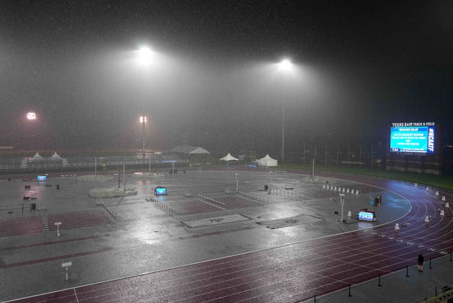 Rain falls during and inclement weather delay Friday at the NCAA West Preliminary meet at E.B. Cushing Stadium in College Station, Texas.