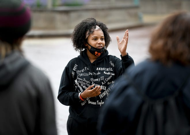 A group of Black Lives Matter activists, including organizer Sierra Mason,  gather in downtown Canton to remember the year which has passed since the death of George Floyd.  Saturday,  May 29, 2021.