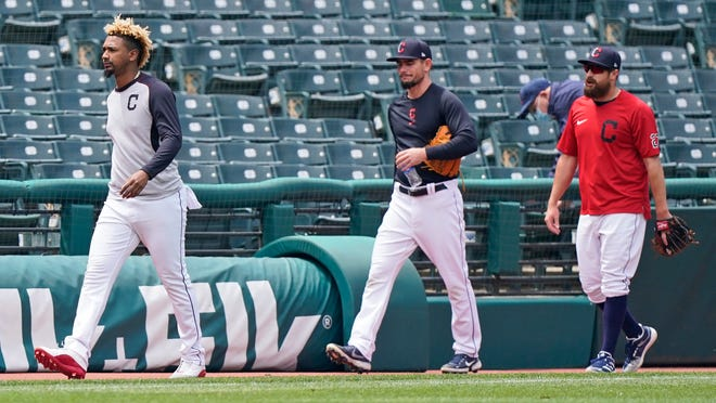 Cleveland relief pitchers, from left, Emmanuel Clase, Nick Wittgren and Bryan Shaw walk off the field after their home game against Toronto was postponed due to inclement weather, Saturday, May 29, 2021. The game will be rescheduled as a traditional doubleheader Sunday. (AP Photo/Tony Dejak)