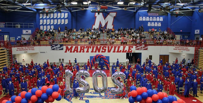 Members of the Martinsville High School Class of 2021 stand during Friday's ceremony.