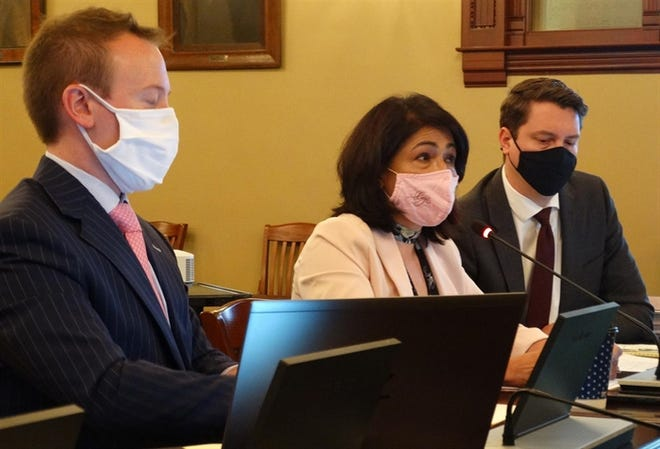 State Rep. Elizabeth Hernandez, center, chairwoman of the House Redistricting Committee, answers questions about a proposed map of new House and Senate districts during a hearing Friday, May 28, 2021, in the Statehouse.