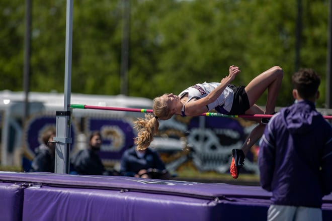 Hononegah's Christine Nielsen tries to get over the bar in the high jump during the girls NIC-10 track and field meet on Saturday, May 29, 2021, in Belvidere.