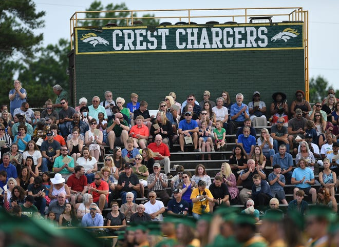 Family and friends gather at Crest High School Friday evening for the 2021 graduation ceremony.