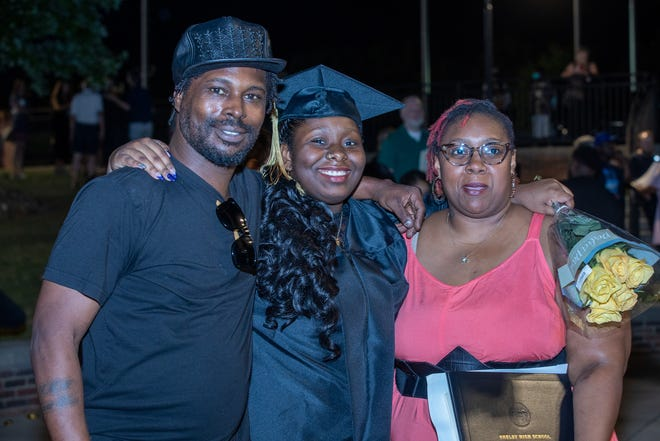 Families posed for photos with graduates Friday night at Shelby High School.