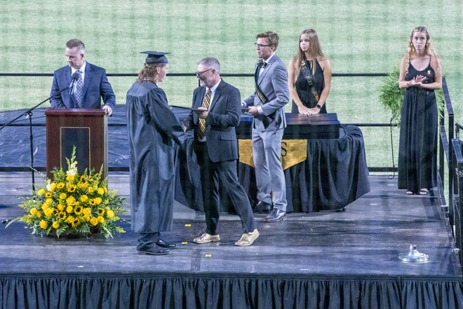 Seniors cross the stage Friday night at Shelby High School.