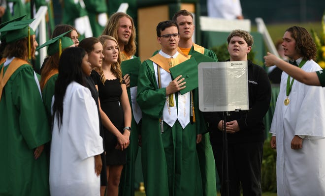 Members of the Crest High School Choral Ensemble perform the National Anthem during the opening ceremony.