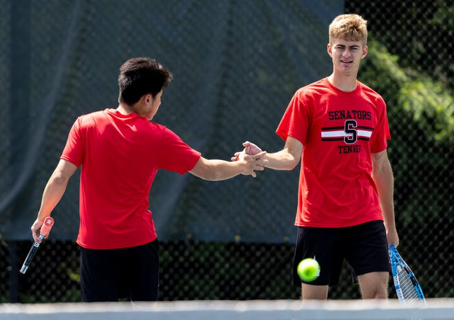 Springfield's David Jiang and Brian Becker celebrate a point against Glenwood in the doubles championship during the Boys CS8 Tournament in Washington Park in Springfield, Ill., Saturday, May 29, 2021. [Justin L. Fowler/The State Journal-Register]