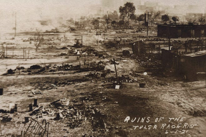 This photo provided by the Department of Special Collections, McFarlin Library, The University of Tulsa shows the ruins of Dunbar Elementary School and the Masonic Hall in the aftermath of the Tulsa Race Massacre in Tulsa, Oklahoma. The massacre started on May 31, 1921.