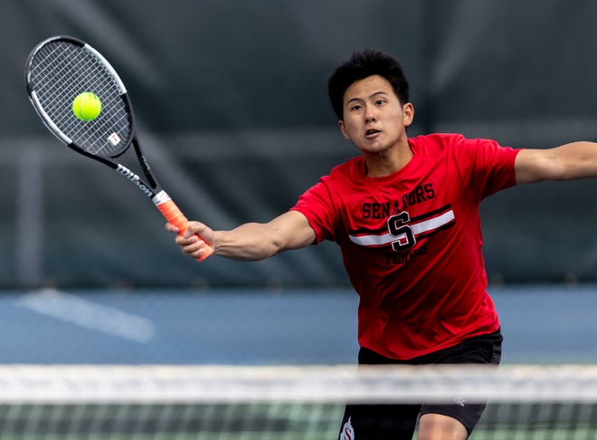Springfield's David Jiang returns a hit from Glenwood in the doubles championship during the Boys CS8 Tournament in Washington Park in Springfield on Saturday. [Justin L. Fowler/The State Journal-Register]