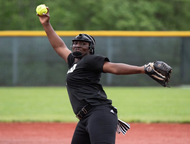 Topeka High's NiJaree Canady delivers a pitch during the Class 6A state tournament championship game against Olathe North on Friday in Shawnee. The Trojans won 7-1 to complete a 25-0 season.