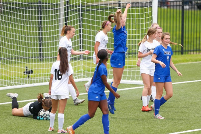 Washburn Rural sophomore Brooklyn DeLeye celebrates after scoring against Manhattan in the second half of the Class 6A state tournament consolation match Saturday at Hummer Sports Park. The Junior Blues won 3-1.