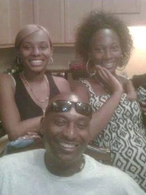 Laticia Brown, right, is shown here with her family. Brown is charged in the April killing of Eric Robinson. Court documents reveal new details about her alleged involvement with the case.