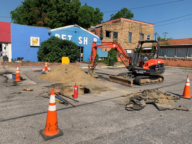 A backhoe sits outside the burned Aqua-Rama Pet Shop on Bragg Boulevard on Friday. Crews were at the business to prepare the location for demolition expected to begin this week. The shop was destroyed by fire April 25.