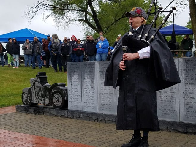 Betsy Bethel-McFarland of Martins Ferry plays the bagpipes at Saturday's rededication of the Motorcyclist Memorial in Hopedale.